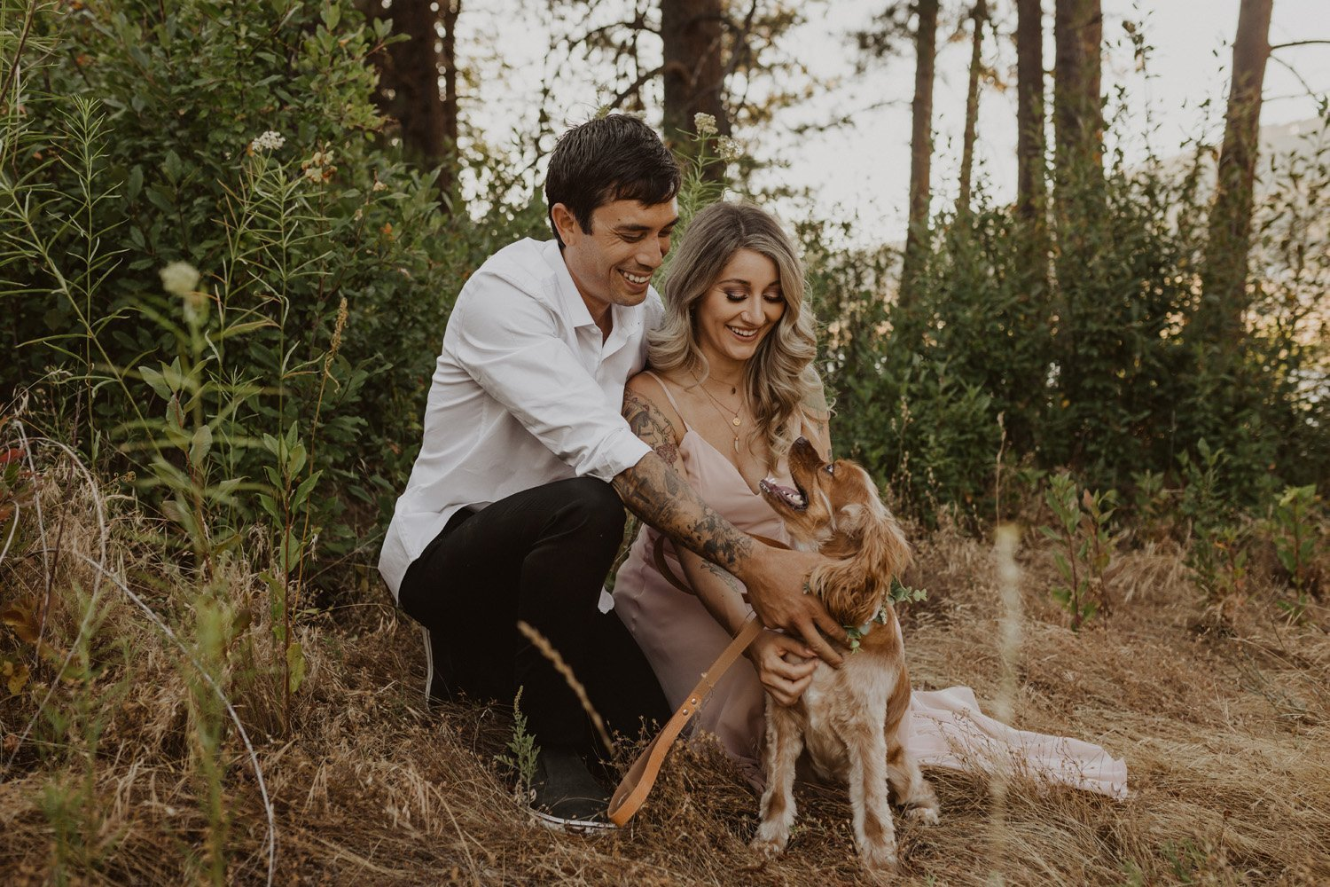 Couple laughing with dog at their Julian, CA engagement session