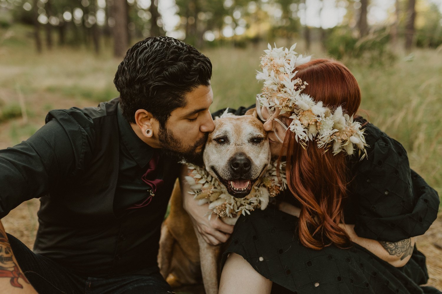 Woman in flower crown cuddling dog with her boyfriend at their Sunrise Highway Couples Session
