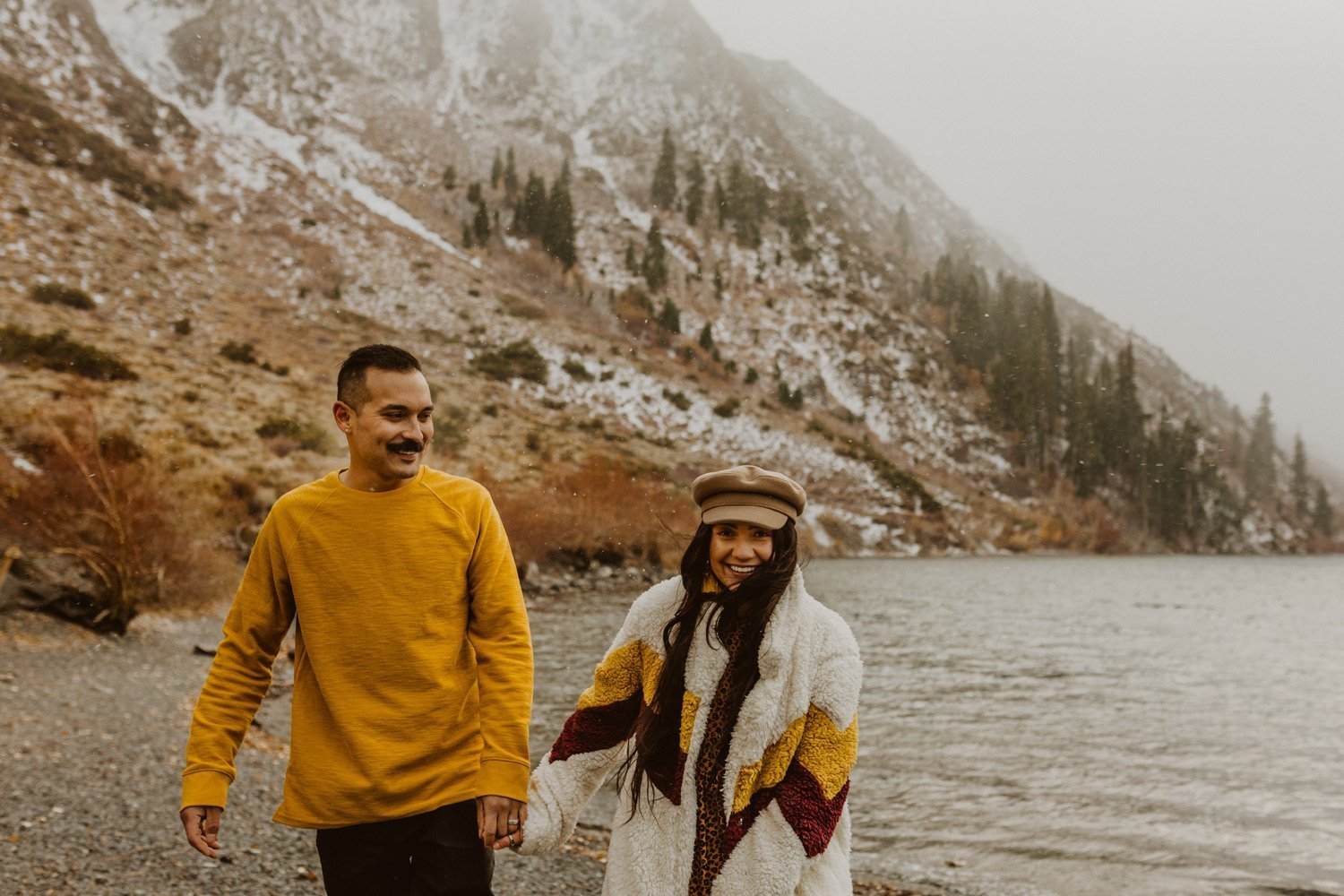 Couple laughing at their Convict Lake couples session.