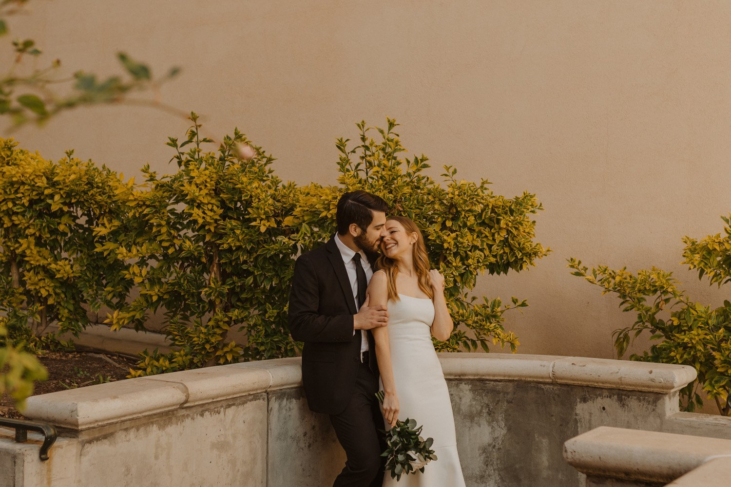 Bride and groom embracing at their Balboa Park wedding.