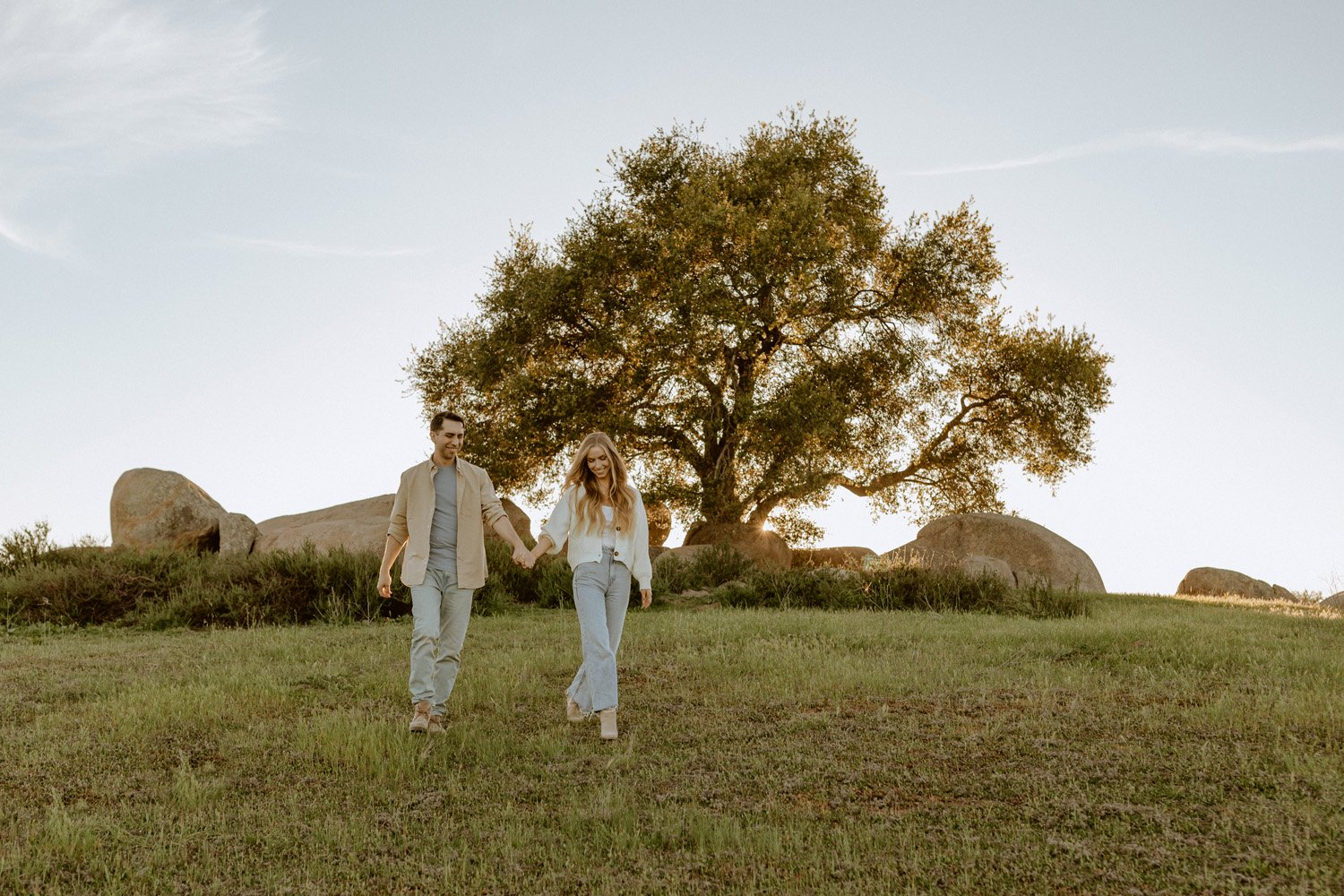 Couple holding hands at their Ramona Grasslands engagement session.